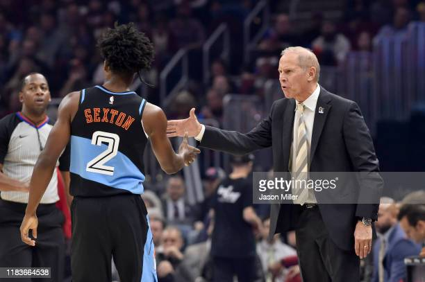 Collin Sexton celebrates with head coach John Beilein of the Cleveland Cavaliers during the first half against the Indiana Pacers at Rocket Mortgage...