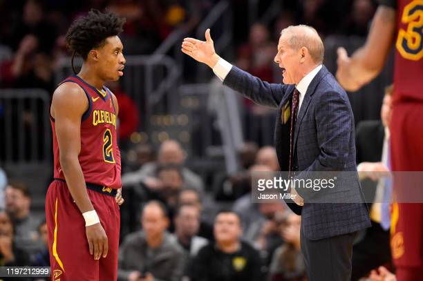 Collin Sexton listens to head coach John Beilein of the Cleveland Cavaliers during the second half against the Charlotte Hornets at Rocket Mortgage...