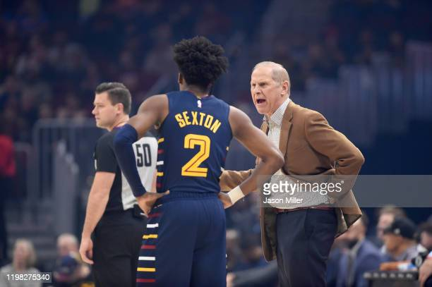 Collin Sexton listens to Head coach John Beilein of the Cleveland Cavaliers during the first half against the Detroit Pistons at Rocket Mortgage...