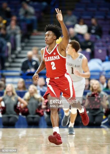 Collin Sexton of the Alabama Crimson Tide celebrates after making a three point shot against the Texas AM Aggies during the second round of the 2018...