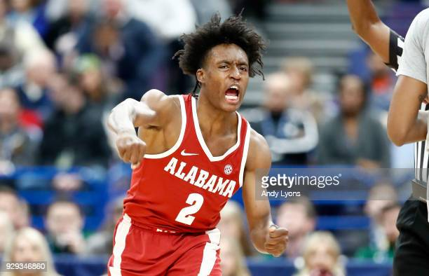 Collin Sexton of the Alabama Crimson Tide celebrates against the Texas AM Aggies during the second round of the 2018 SEC Basketball Tournament at...