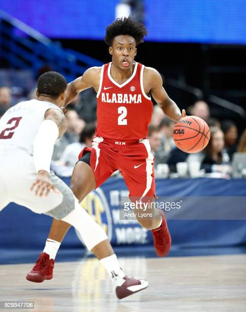 Collin Sexton of the Alabama Crimson Tide dribbles the ball against the Texas AM Aggies during the second round of the 2018 SEC Basketball Tournament...