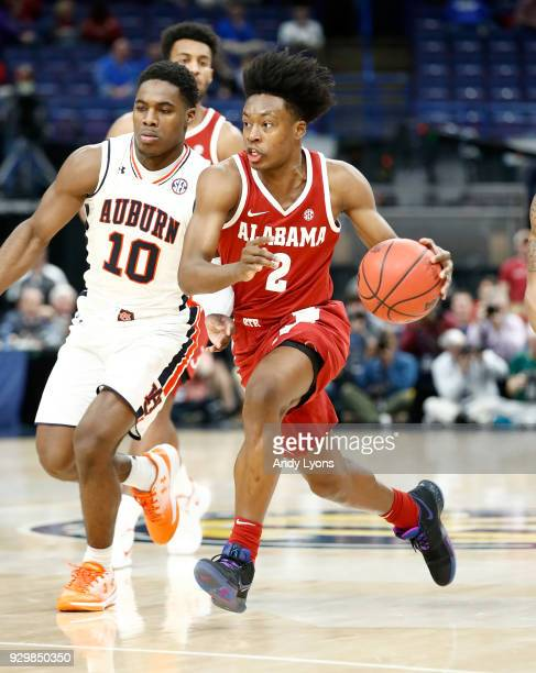 Collin Sexton of the Alabama Crimson Tide dribbles the ball against the Auburn Tigers during the quarterfinals round of the 2018 SEC Basketball...