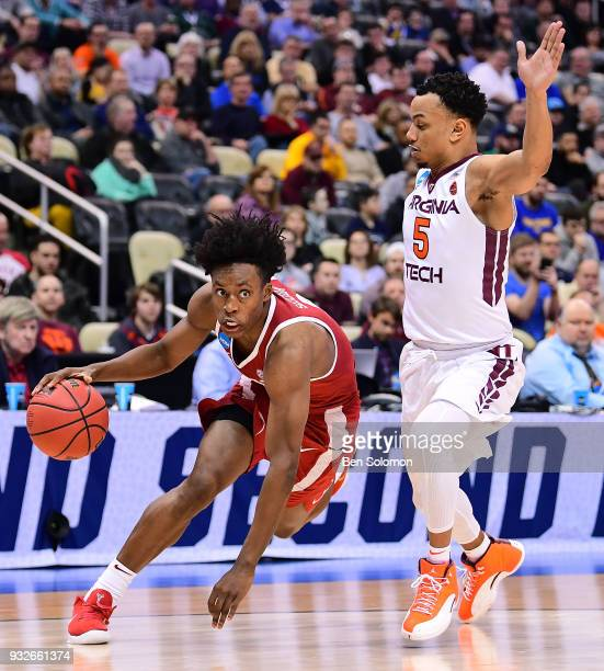 Collin Sexton of the Alabama Crimson Tide drives to the basket against Justin Robinson of the Virginia Tech Hokies in the first half during the first...