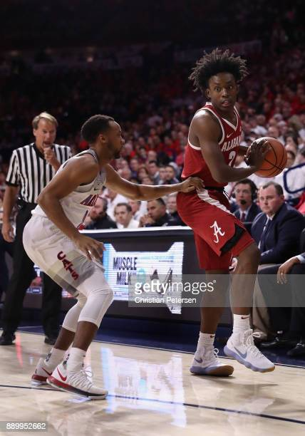 Collin Sexton of the Alabama Crimson Tide handles the ball against Parker JacksonCartwright of the Arizona Wildcats during the first half of the...