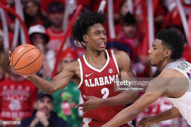 Collin Sexton of the Alabama Crimson Tide passes the ball around Allonzo Trier of the Arizona Wildcats during the second half of the college...