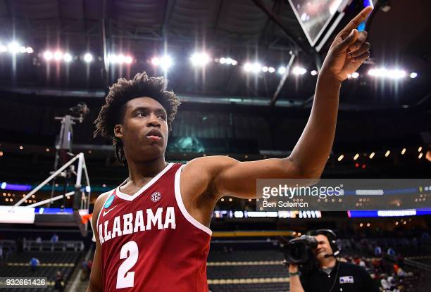 Collin Sexton of the Alabama Crimson Tide points to the crowd as he walks off the court following the Alabama Crimson Tide 8683 win over the Virginia...