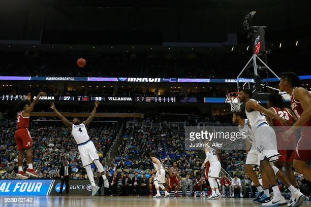 Collin Sexton of the Alabama Crimson Tide shoots the ball against Eric Paschall of the Villanova Wildcats during the second half in the second round...