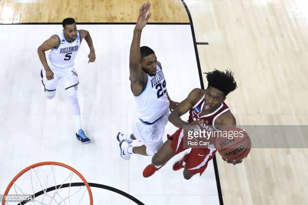 Collin Sexton of the Alabama Crimson Tide shoots the ball against Mikal Bridges of the Villanova Wildcats in the second round of the 2018 NCAA Men's...