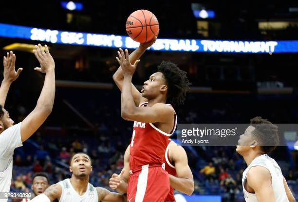 Collin Sexton of the Alabama Crimson Tide shoots the ball against the Texas AM Aggies during the second round of the 2018 SEC Basketball Tournament...