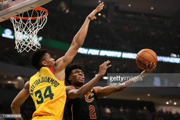 Collin Sexton of the Cleveland Cavaliers attempts a shot while being guarded by Giannis Antetokounmpo of the Milwaukee Bucks in the first quarter at...