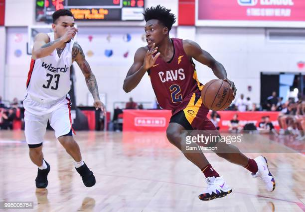 Collin Sexton of the Cleveland Cavaliers dribbles against Chris Chiozza of the Washington Wizards during the 2018 NBA Summer League at the Cox...