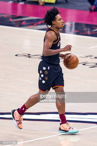 Collin Sexton of the Cleveland Cavaliers dribbles the ball down the court during the first quarter against the Golden State Warriors at Rocket...