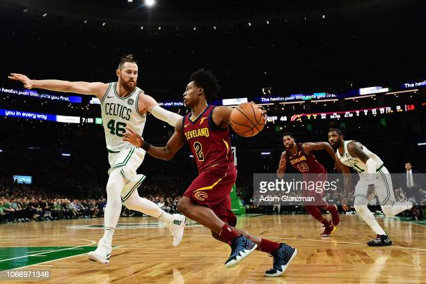 Collin Sexton of the Cleveland Cavaliers dribbles the ball while guarded by Aron Baynes of the Boston Celtics in the second quarter of a game at TD...