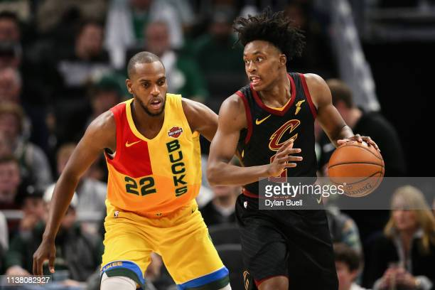 Collin Sexton of the Cleveland Cavaliers dribbles the ball while being guarded by Khris Middleton of the Milwaukee Bucks in the third quarter at the...