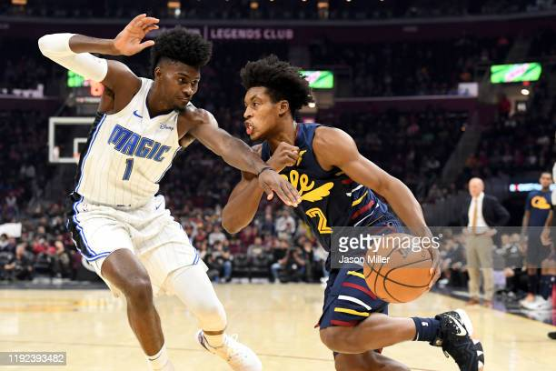 Collin Sexton of the Cleveland Cavaliers drives around Jonathan Isaac of the Orlando Magic during the second half at Rocket Mortgage Fieldhouse on...