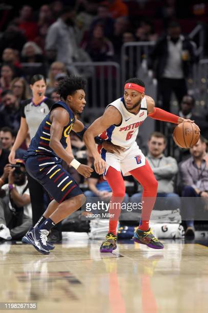 Collin Sexton of the Cleveland Cavaliers guards Bruce Brown of the Detroit Pistons during the second half at Rocket Mortgage Fieldhouse on January 07...