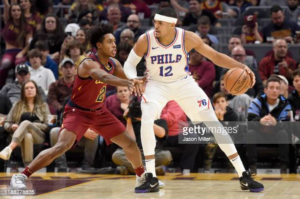 Collin Sexton of the Cleveland Cavaliers guards Tobias Harris of the Philadelphia 76ers during the first half at Rocket Mortgage Fieldhouse on...