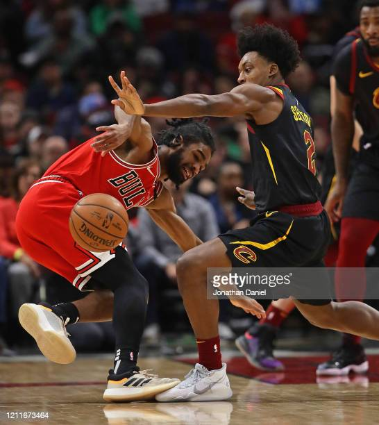 Collin Sexton of the Cleveland Cavaliers knocks the ball away from Coby White of the Chicago Bulls at the United Center on March 10 2020 in Chicago...