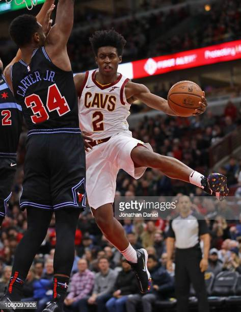 Collin Sexton of the Cleveland Cavaliers passes around Wendell Carter Jr #34 of the Chicago Bulls at the United Center on November 10 2018 in Chicago...