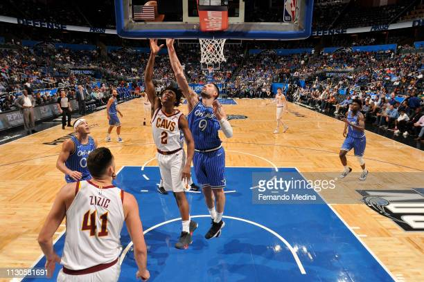 Collin Sexton of the Cleveland Cavaliers puts up the shot over Nikola Vucevic of the Orlando Magic on March 14 2019 at Amway Center in Orlando...
