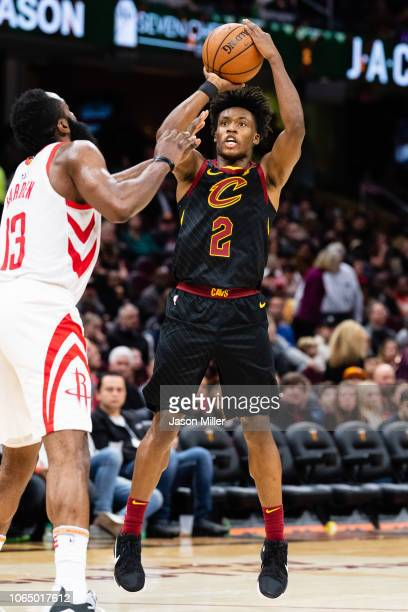 Collin Sexton of the Cleveland Cavaliers shoots over James Harden of the Houston Rockets during the second half at Quicken Loans Arena on November 24...