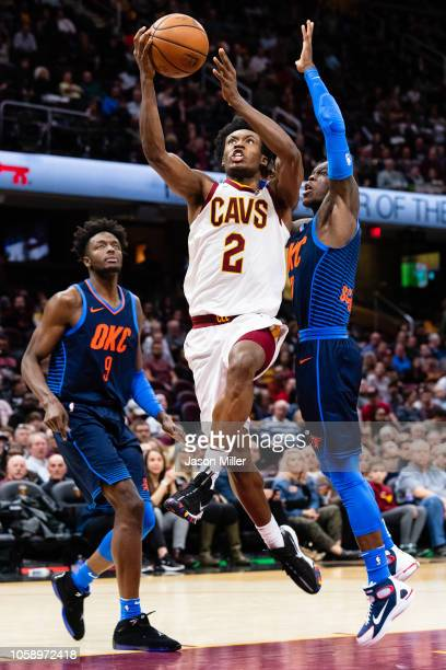 Collin Sexton of the Cleveland Cavaliers shoots over Jerami Grant and Dennis Schroder of the Oklahoma City Thunder during the second half at Quicken...