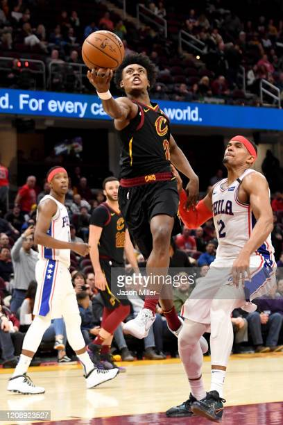 Collin Sexton of the Cleveland Cavaliers shoots over Tobias Harris of the Philadelphia 76ers during the second half at Rocket Mortgage Fieldhouse on...