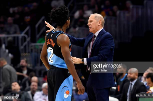 Collin Sexton of the Cleveland Cavaliers talks to head coach John Beilein during the first half against the Portland Trail Blazers at Rocket Mortgage...
