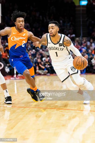 Collin Sexton of the Cleveland Cavaliers tries to guard D'Angelo Russell of the Brooklyn Nets during the second half at Quicken Loans Arena on...
