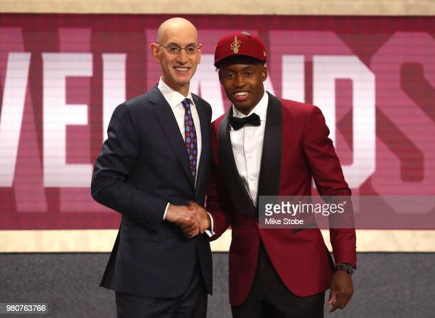 Collin Sexton poses with NBA Commissioner Adam Silver after being drafted eighth overall by the Cleveland Cavaliers during the 2018 NBA Draft at the...