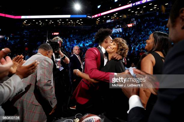 Collin Sexton reacts after being selected eighth overall by the Cleveland Cavaliers on June 21 2018 at Barclays Center during the 2018 NBA Draft in...