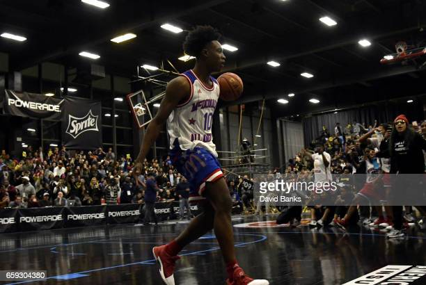 Collin Sexton reacts after dunking during the 2017 McDonald's All American games POWERADE Jam Fest on March 27 2017 at the Illinois Institute of...