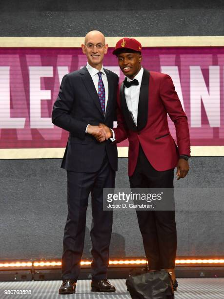 Collin Sexton shakes hands with NBA Commissioner Adam Silver after being selected number eight overall by the Cleveland Cavaliers during the 2018 NBA...