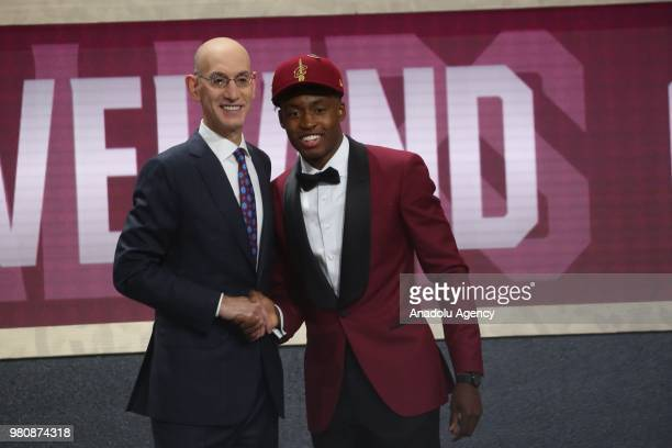 Collin Sexton shakes hands with NBA Commissioner Adam Silver after being drafted eighth overall by the Cleveland Cavaliers during the 2018 NBA Draft...