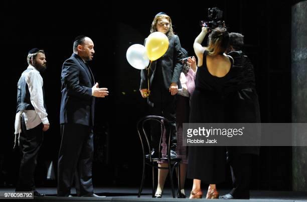 Collin Shay as Yoel Netanel Hershtik as David Edward Hyde as Young Yoel and Paulina Jurzec as Live camera in the Royal Opera's production of Na'ama...