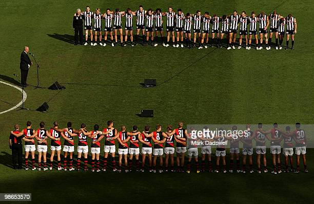 Collingwood and Essendon players line up for the minutes silence marking Anzac Day during the round five AFL match between the Collingwood Magpies...