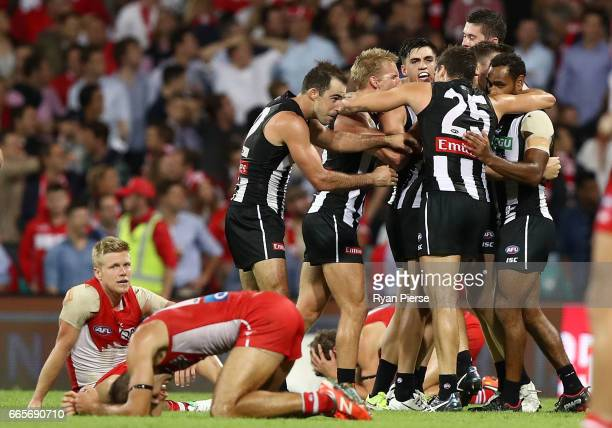 Collingwood celebrate victory on the siren during the round three AFL match between the Sydney Swans and the Collingwood Magpies at Sydney Cricket...