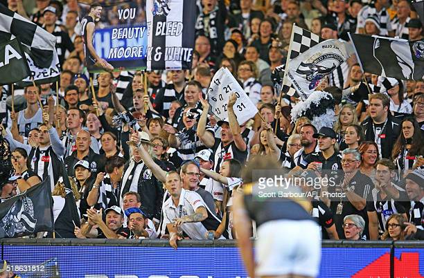 Collingwood fans in the crowd yell as a Tigers player lines up a shot at goal during the round two AFL match between the Collingwood Magpies and the...