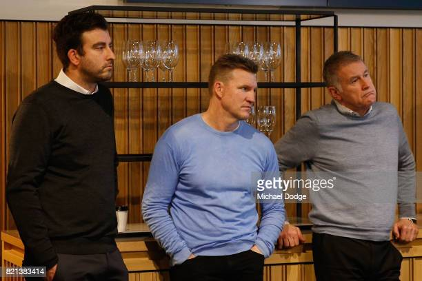Collingwood head coach Nathan Buckley and football manager Geoff Walsh listen as Collingwood Magpies AFL CEO Gary Pert announces his resignation...
