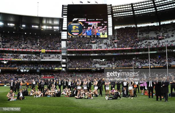 Collingwood look on as the Eagles lift the Premiership Cup during the 2018 AFL Grand Final match between the Collingwood Magpies and the West Coast...