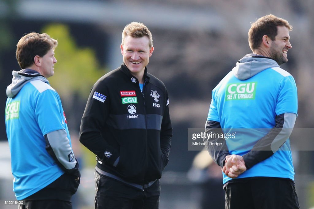 Collingwood Magpies AFL coach Nathan Buckley speaks to assistant coach Robert Harvey (L) during a Collingwood Magpies AFL training at the Holden Centre on July 11, 2017 in Melbourne, Australia.