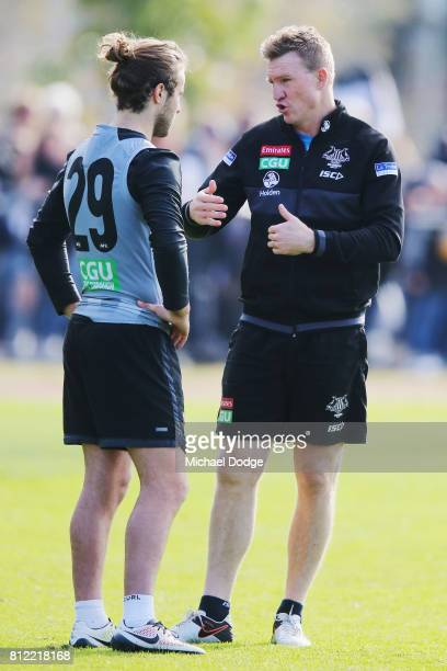 Collingwood Magpies AFL coach Nathan Buckley speaks to Tim Broomhead during a Collingwood Magpies AFL training at the Holden Centre on July 11 2017...
