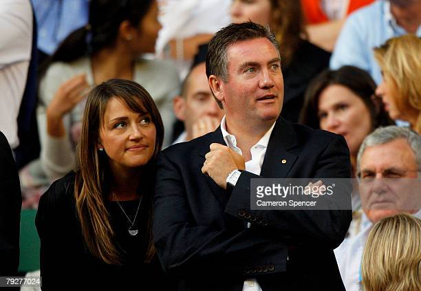 Collingwood Magpies AFL President and TV personality Eddie McGuire and wife Carla arrive to watch the men's final match between JoWilfried Tsonga of...