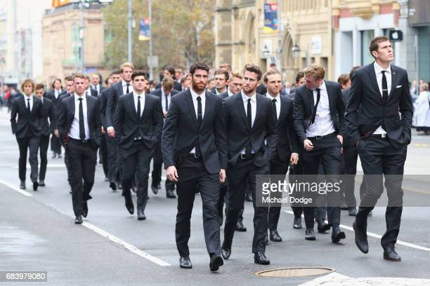 Collingwood Magpies leave after their guard of honour during the Lou Richards State Funeral Service at St Paul's Cathedral on May 17 2017 in...