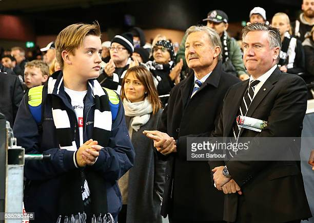 Collingwood president Eddie McGuire his wife Carla McGuire and son Alexander McGuire look on as the Magpies leave the field after losing during the...