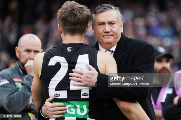 Collingwood president Eddie McGuire hugs Josh Thomas of the Magpies after their loss during the 2018 AFL Grand Final match between the Collingwood...