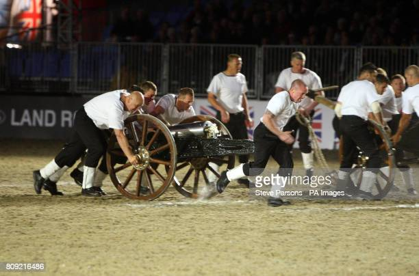 HMS Collingwood take part in the field gun race at the Windsor Castle Tattoo