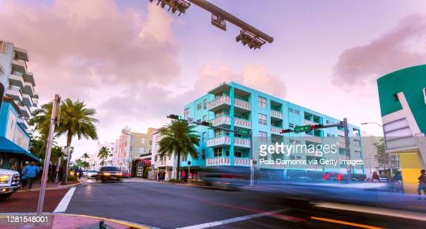 collins avenue close to south beach in art deco and shopping district, miami, usa. - miami stock pictures, royalty-free photos & images