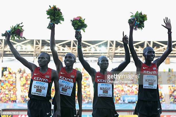 Collins Cheboi, Silas Kiplagat, James Kiplagat Magut and Asbel Kiprop of Kenya celebrate on the podium after winning and setting a new world record...